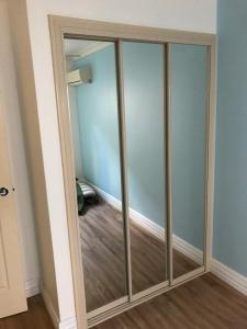 Hinged to Sliding Door Conversion